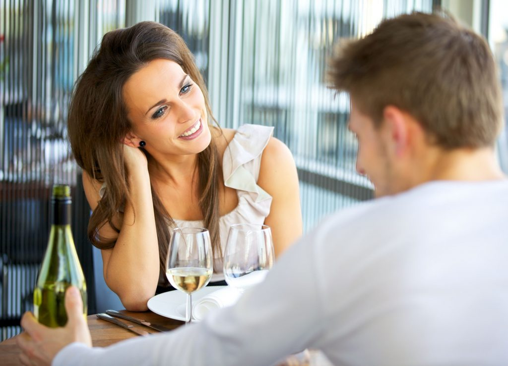 13518800 - portrait of a romantic dating couple at a restaurant