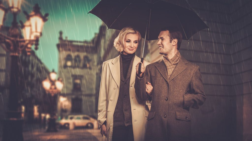 39255088 - elegant couple with umbrella walking outdoors in the rain
