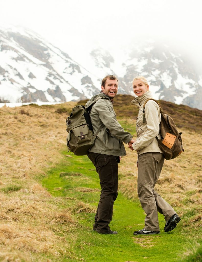 19811732 - happy young hiker couple with backpacks in mountains