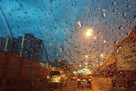 41614826 - blur rain drops on window rainy days rainy weather heavy rain bangkok expressway in rainy twilight